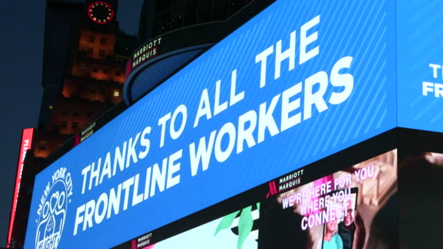 billboard in times square, new york, says thank you to all our frontline workers, during coronavirus crisis - short phrase stock videos & royalty-free footage