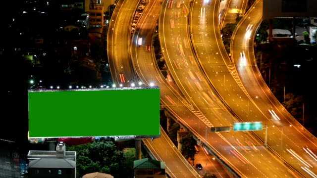 billboard on the highway with light trails traffic - template stock videos and b-roll footage