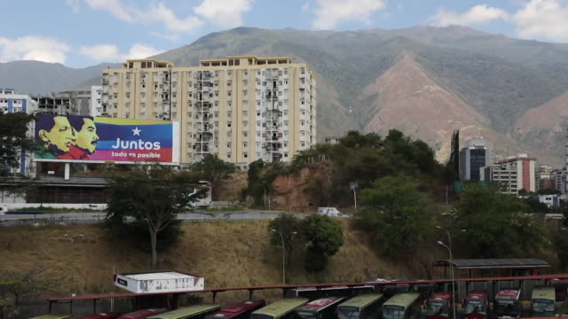 billboard showing poster of venezuelan president nicholas maduro in caracas - poster stock videos & royalty-free footage