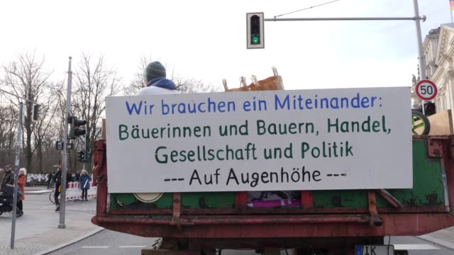 """billboard with the inscription """"we need cooperation. citizens, trade, society and politics at eye level"""" at a demonstration for more sustainable and... - politics and government stock videos & royalty-free footage"""