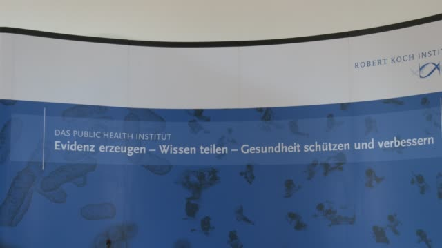 billboard with the logo of the robert koch institute, german government's central institution for the identification, surveillance and prevention of... - number 9 video stock e b–roll