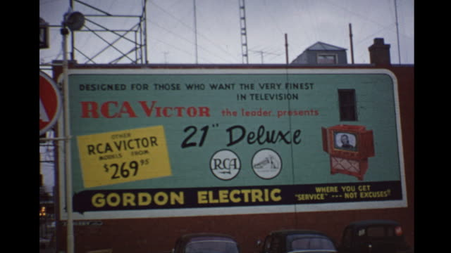 stockvideo's en b-roll-footage met 1955 montage billboards for rca / toronto, canada - 1955