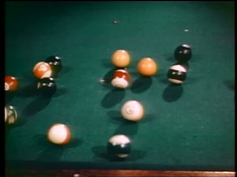 vídeos de stock e filmes b-roll de 1945 billiard ball formation breaking on table / industrial - mesa de bilhar