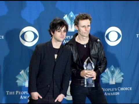 billie joe armstrong and mike dirnt of green day at the 2006 people's choice awards press room at the shrine auditorium in los angeles, california on... - performance group stock videos & royalty-free footage