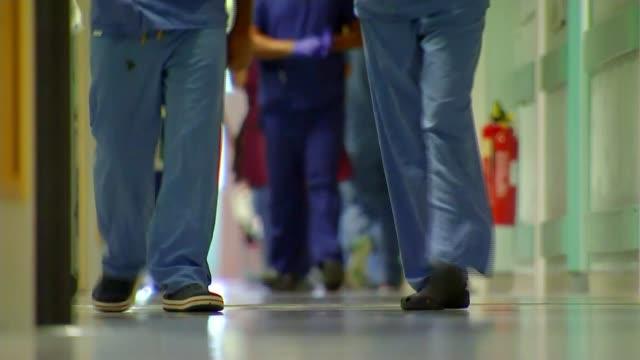 £20 billion NHS boost to come mostly from taxes R04101613 / Blackburn Royal Blackburn Hospital INT Nurses and doctors feet as along corridor **Hopson...