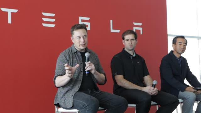 billionaire elon musk, chief executive officer of tesla motors inc, left, speaks as jeffrey straubel, chief technical officer and co-founder of tesla... - sparks点の映像素材/bロール