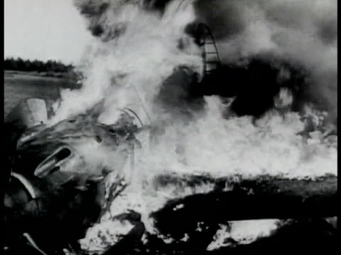 billowing black gray smoke russian airplane on ground on fire burning graphic dead soviet pilot soldier placed on stretcher soldier speaking over... - eulogy stock videos & royalty-free footage