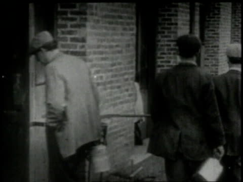1913 montage billowing smokestacks and factory workers / new york, new york, united states - 1913 stock-videos und b-roll-filmmaterial