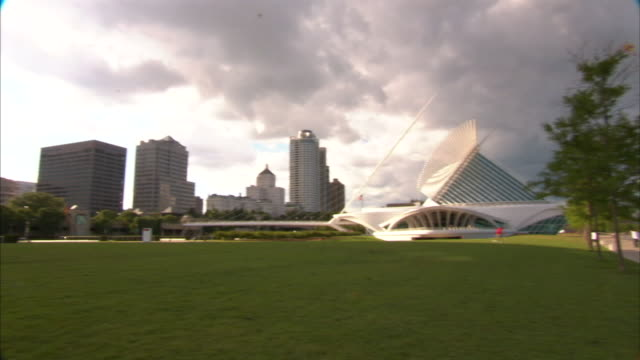 billowy clouds hover over a milwaukee skyline. - wisconsin stock videos & royalty-free footage