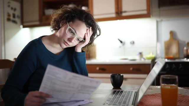 bills give her headache - financial bill stock videos & royalty-free footage