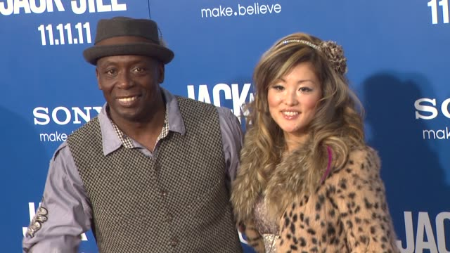 billy blanks and tomoko sato at the 'jack and jill' world premiere at westwood ca - ウェストウッド地区点の映像素材/bロール
