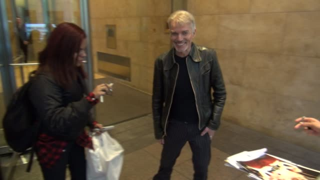 Billy Bob Thornton exits SiriusXM Satellite Radio poses with signs for fans before getting into his car in Celebrity Sightings in New York