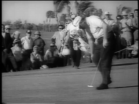 billy casper sinking his putt throwing hat in air at doralryder open / newsreel - doral stock videos and b-roll footage