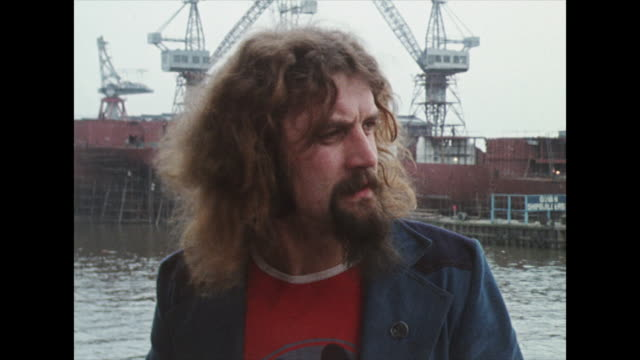 billy connolly, at glasgow docks, recalling his time working in the glasgow shipyards, working with interesting people in response to a question abut... - comedian stock videos & royalty-free footage