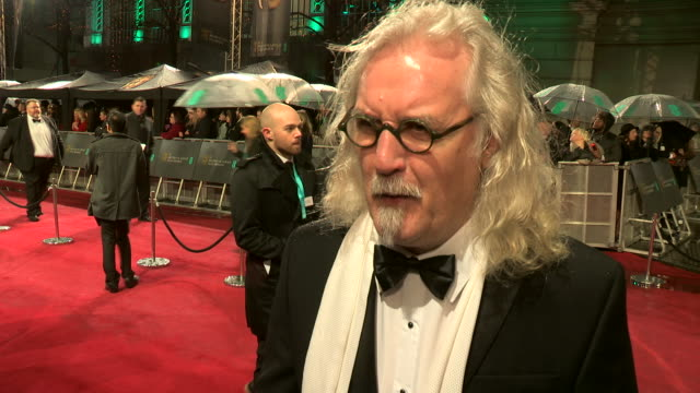 stockvideo's en b-roll-footage met interview billy connolly on being at the awards who he thinks will win at ee british academy film awards 2013 red carpet arrivals at the royal opera... - billy connolly