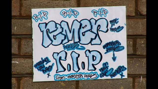 friends and family speak out police 'scene of crime' notices on pavement close shot sign sign on wall 'remer rip' back view plain clothes officer... - tag 2 stock-videos und b-roll-filmmaterial