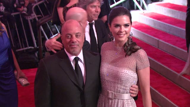 stockvideo's en b-roll-footage met billy joel and katie lee joel at the 'the model as muse embodying fashion' costume institute gala at the metropolitan museum of art arrivals at new... - billy joel