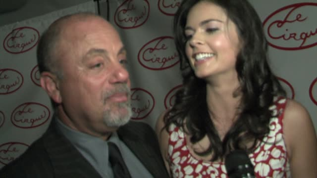 stockvideo's en b-roll-footage met billy joel and katie lee joel on his touring this summer and her cooking show at the opening party for le cirque at le cirque in new york new york on... - billy joel