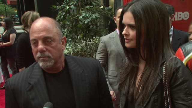 stockvideo's en b-roll-footage met billy joel on coming out for the premiere his projects and his daughter alexa rae joel at the 'entourage' fourth season premiere at ziegfeld theatre... - billy joel