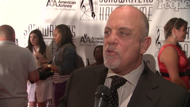 stockvideo's en b-roll-footage met billy joel on why he did not allow the release of his memoir at the songwriters hall of fame 2011 annual awards gala at new york ny - billy joel