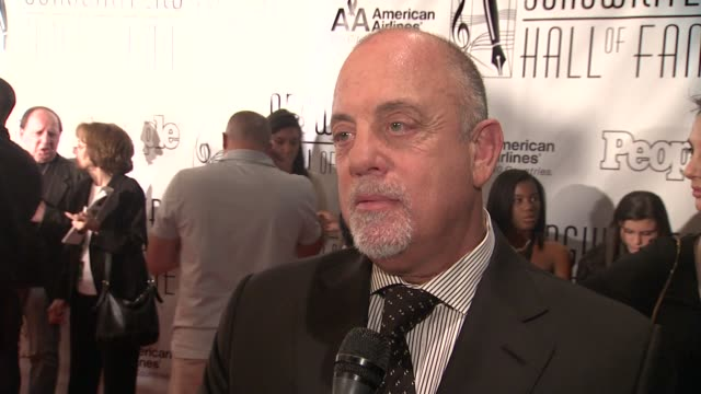 stockvideo's en b-roll-footage met billy joel says he's here in support of songwriters at the songwriters hall of fame 2011 annual awards gala at new york ny - billy joel