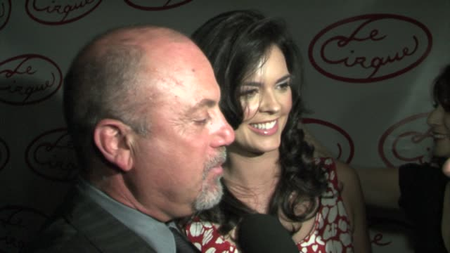 stockvideo's en b-roll-footage met billy joel speaking italian and singing while wife katie lee joel looks on at the opening party for le cirque at le cirque in new york new york on... - billy joel
