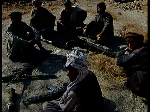 Bin Laden/Kandahar/British troops LIB Northern Alliance soldier hitting out at cameraman with rifle