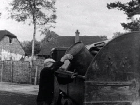 bin men empty bins into an old dust cart. - manual worker stock videos & royalty-free footage