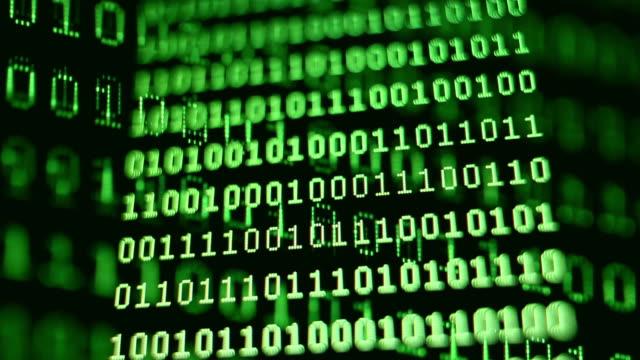 ecu selective focus binary code on computer screen - 永久運動点の映像素材/bロール