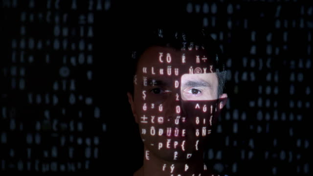 binary data projection on a man's face - human face collage stock videos & royalty-free footage
