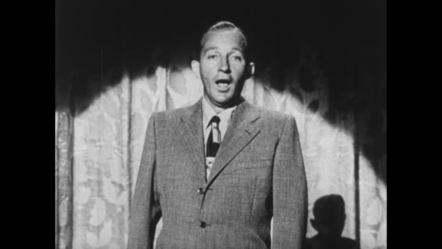 stockvideo's en b-roll-footage met bing crosby sings about buying war bonds - bing crosby