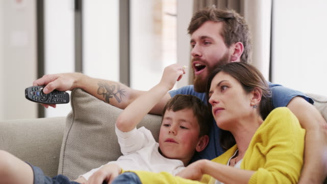 binge watching with our bunch - two parents stock videos & royalty-free footage