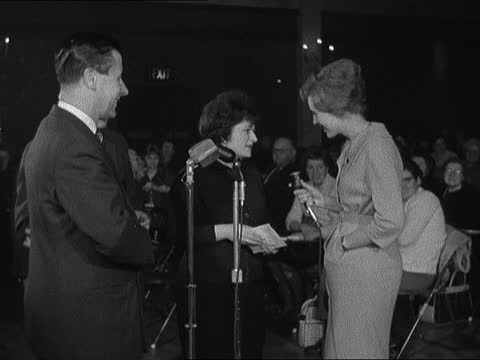 north london: tottenham: royal dance hall: int bingo caller with balls hall full of players at desks balls in machine various shots of women crossing... - hackney stock videos & royalty-free footage