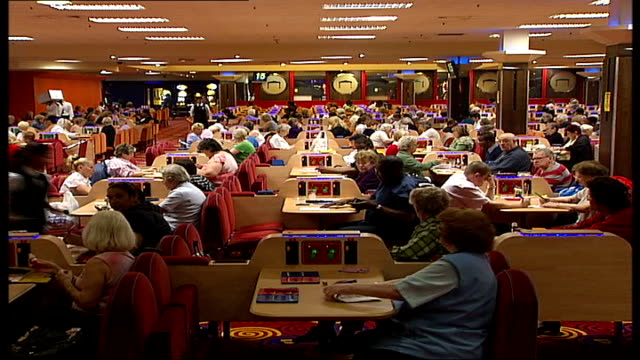 vídeos y material grabado en eventos de stock de bingo hall claims smoking ban means they will close bingo players sitting marking their cards some smoking - bingo