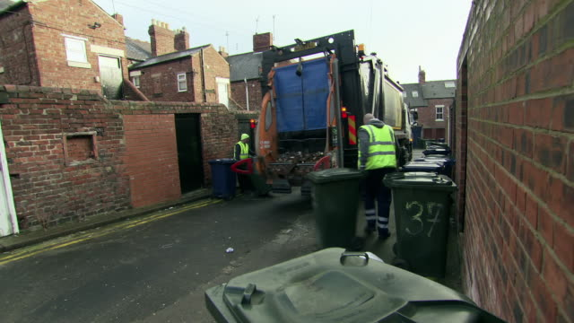 binmen collect rubbish from wheelie bins - newcastle upon tyne video stock e b–roll