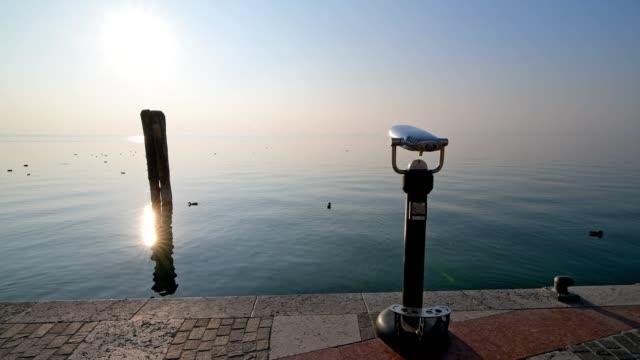binoculars at the lake with sun, lazise, verona, lake garda, lago di garda, veneto, italy - lago stock videos & royalty-free footage