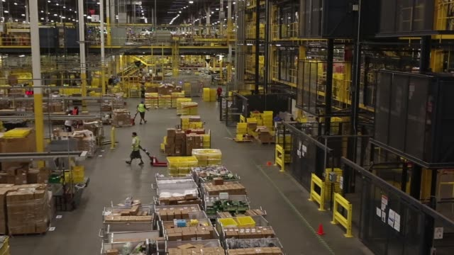 Bins are sorted at an Amazon Fulfillment Center in Robbinsville New Jersey Monday November 27 2017 Photographer Victor J Blue – Shots shot of yellow...