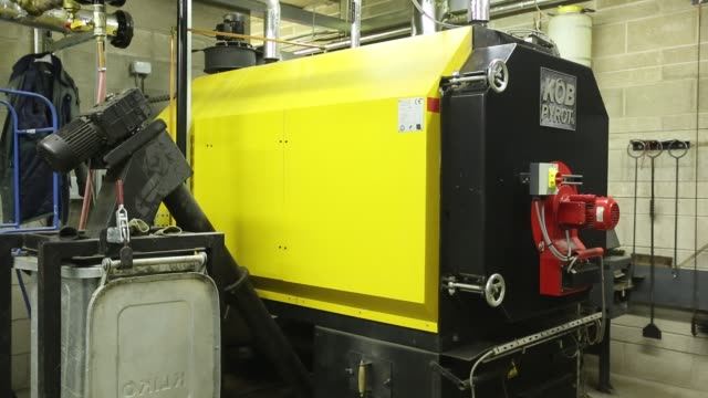 biofuel boiler which provides hot water and space heating for the grizedale forest visitor centre , cumbria, uk - forestry industry stock videos & royalty-free footage