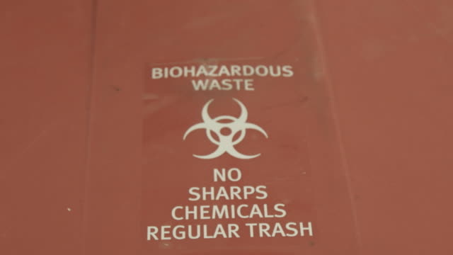 biohazard waste sign, low angle close up - hazardous area sign stock videos & royalty-free footage