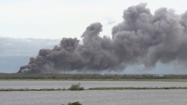 stockvideo's en b-roll-footage met biolab industrial inc chemical plant on fire after hurricane laura impacted the area in westlake, louisiana. - environment or natural disaster or climate change or earthquake or hurricane or extreme weather or oil spill or volcano or tornado or flooding
