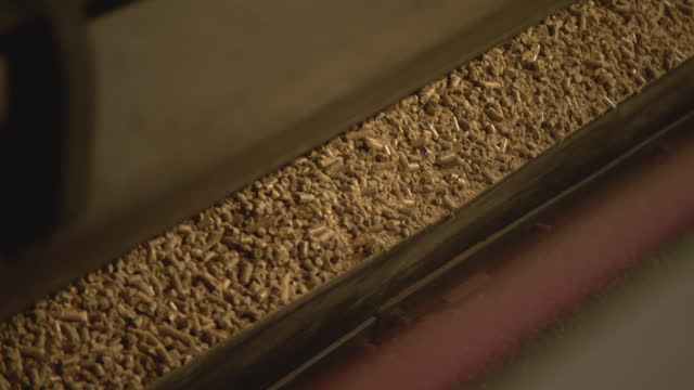 biomass pellets being offloaded from train at power station - railway track stock videos & royalty-free footage