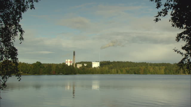 ws biomass plant in woods bordering lake / vaxjo, sweden - vaxjo stock videos & royalty-free footage