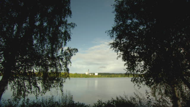 ls ws biomass plant on edge of lake / vaxjo, sweden - vaxjo stock videos & royalty-free footage