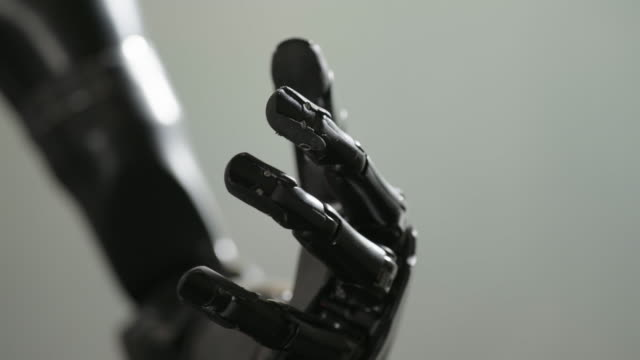 bionic arm closes fist, close up - futuristico video stock e b–roll