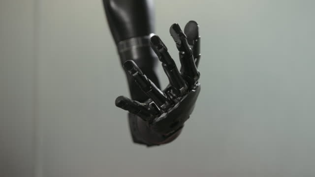 bionic arm closes fist - artificial limb stock videos & royalty-free footage