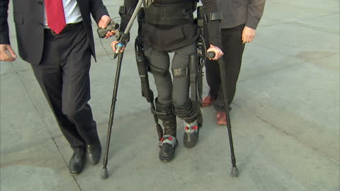 bionic body-suit which enables paraplgics to stand up & walk has been road-tested. the battery-powered device allows people with spinal cord injuries... - leotard stock videos & royalty-free footage