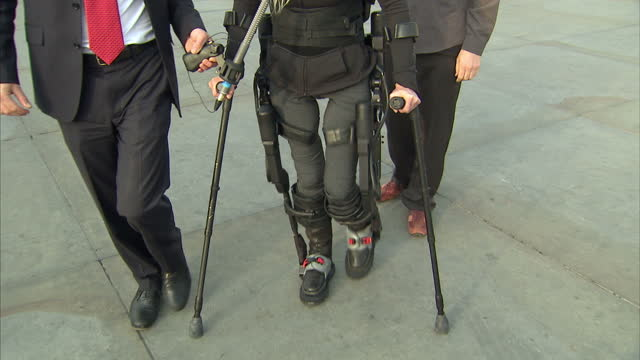 bionic body-suit which enables paraplgics to stand up & walk has been road-tested. the battery-powered device allows people with spinal cord injuries... - paraplegic stock videos & royalty-free footage