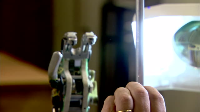 a bionic snave hand in a lab at the university of reading mimics the movements of a human hand. - prosthetic equipment stock videos & royalty-free footage