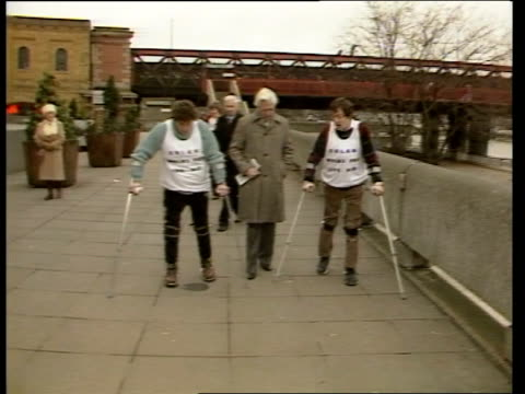 'bionic' walkers england london south bank royal festival hall tms david rutting uses crutches to get out of wheelchairs and moves slowly towards ms... - cyborg stock videos & royalty-free footage