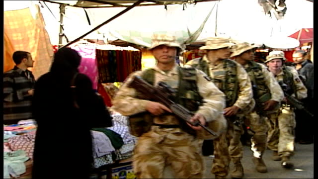 us bipartisan iraq study group teleconference with tony blair file / date unknown basra ext british troops patrolling marketplace - iraq study group stock videos & royalty-free footage